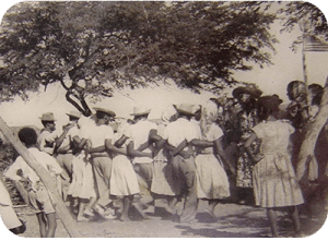 The Simadan (Harvest) Dance, notice the base's U.S. Flag in the upper right corner. Image courtesy of Tanki Maraka Heritage Park.