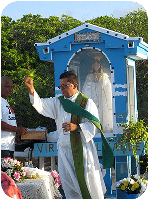 A priest blesses the congregation.