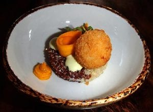 Pumpkin three ways over red and white quinoa, topped with goat cheese, raz el hanout and tarragon.