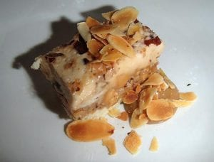 Creamy parfait filled with caramelized nuts and toffee.