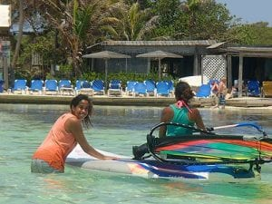 Anyone can learn windsurfing in the shallow waters of Bonaire's Lac Bay.