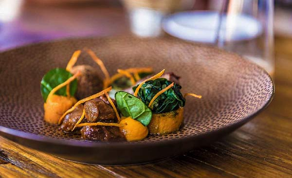 The Goat, the Spinach, and the Sweet Potato in the Flavors of Bonaire Cookbook