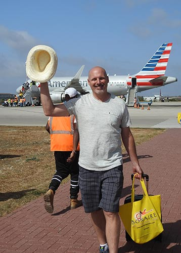 A visitor arrives on American Airlines' inaugural flight to Bonaire.