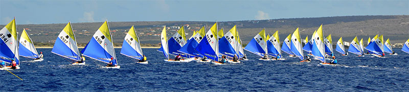 Over 65 Sunfish line up for the starting gun of the Sunfish Worlds 2019.