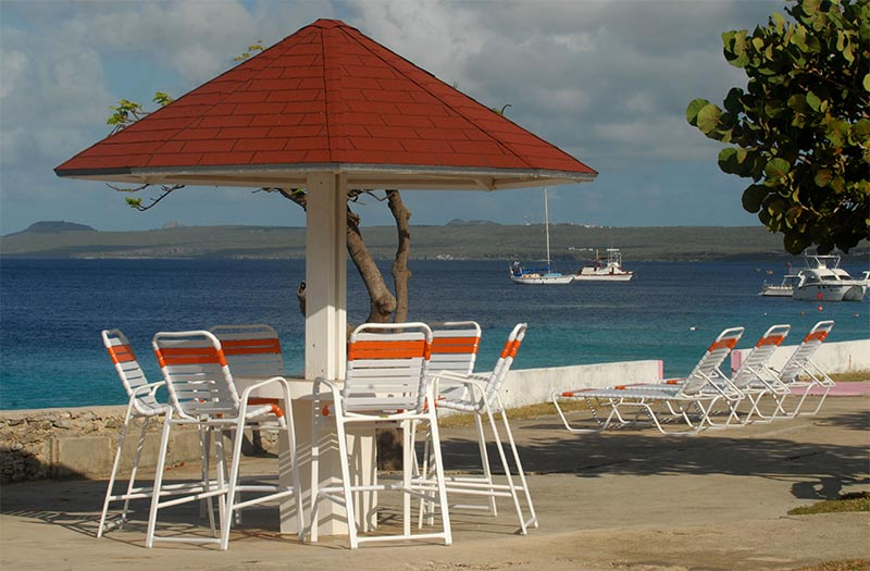 A pagoda and lounge chairs on the deck at Sand Dollar Condominiums.