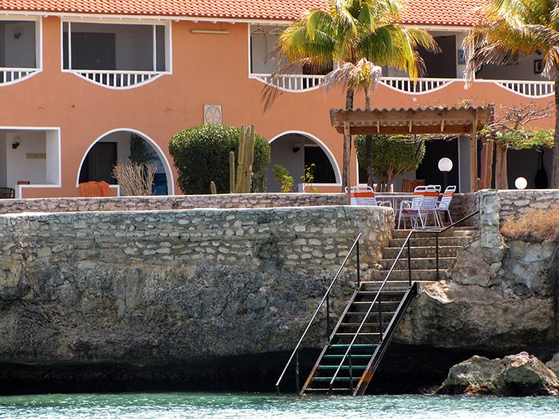 The stairs to enter the water at Sand Dollar Condominiums.